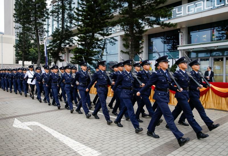 Members of the Hong Kong Police Force march during the ceremonial opening of the legal year at Edinburgh Place in Hong Kong