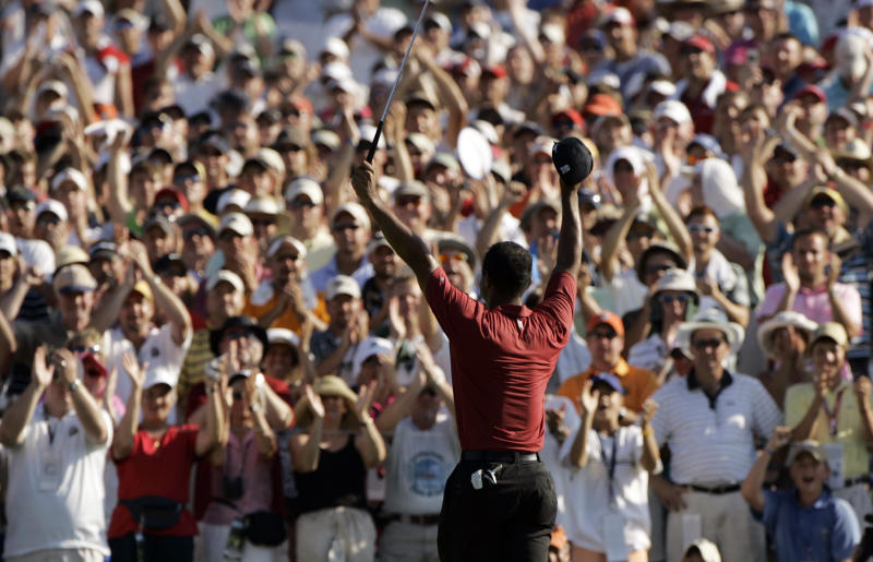 FILE - In this Aug. 12, 2007, file photo, Tiger Woods celebrates after winning the 89th PGA Golf Championship at the Southern Hills Country Club in Tulsa, Okla. The next PGA Championship at Southern Hills will be in 2030. (AP Photo/Charlie Riedel, File)