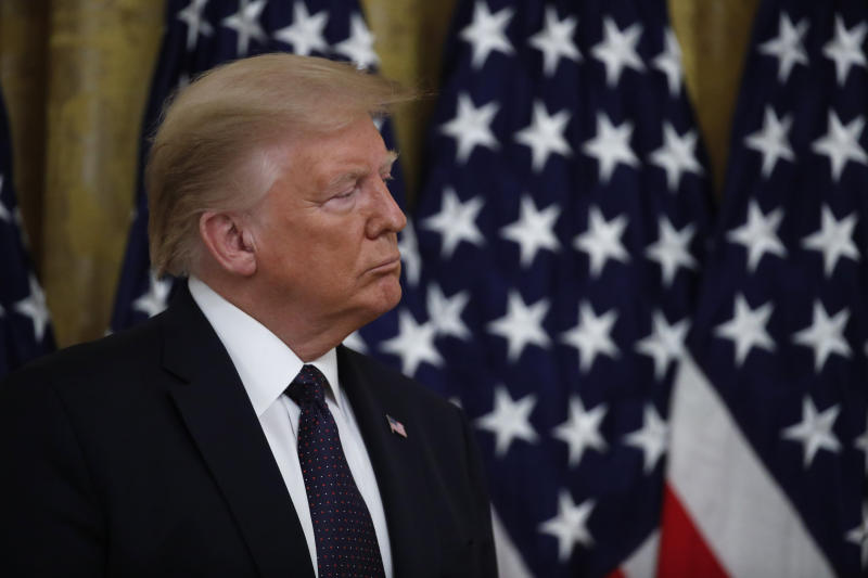 """President Donald Trump listens during an event about the PREVENTS """"President's Roadmap to Empower Veterans and End a National Tragedy of Suicide,"""" task force, in the East Room of the White House, Wednesday, June 17, 2020, in Washington. (AP Photo/Alex Brandon)"""