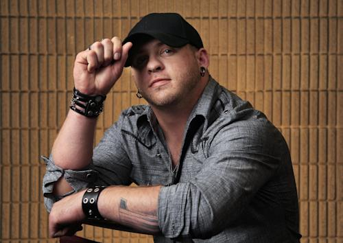 This March 8, 2012 photo shows Brantley Gilbert in Nashville, Tenn. Gilbert is one of several male performers included in the fan-voted top new artist category at the Academy of Country Music Awards. (AP Photo/Mark Humphrey)