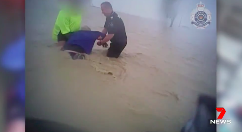 Townsville floods: Police rescue stranded man from flooded house