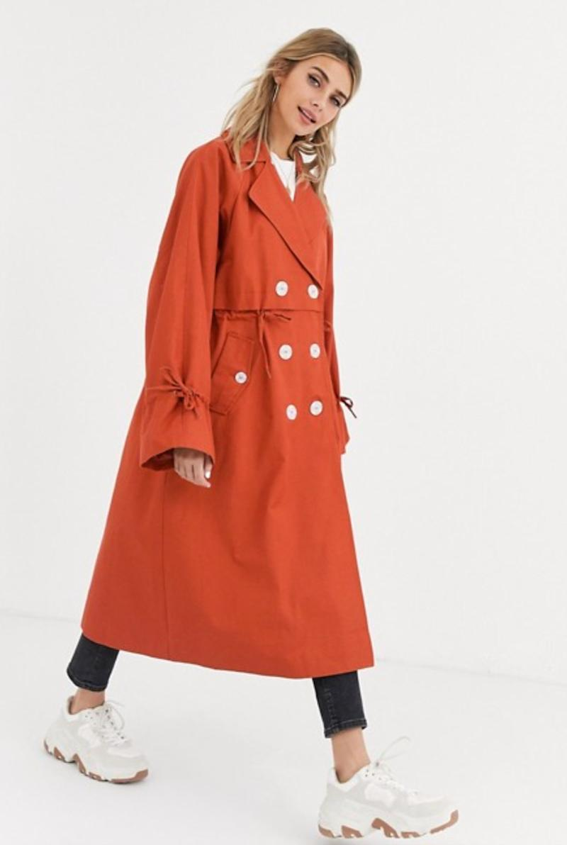 ASOS DESIGN luxe contrast button trench coat in rust (photo via ASOS)