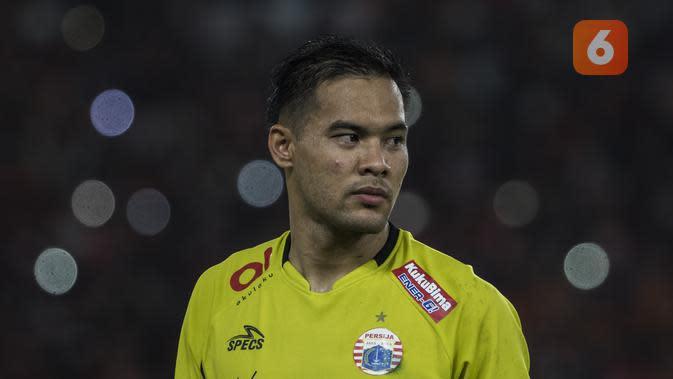 Kiper Persija Jakarta, Andritany Ardhiyasa, usai tampil melawan Arema FC pada laga Liga 1 di SUGBK, Jakarta, Sabtu (31/3/2018) (Bola.com/Vitalis Yogi Trisna)