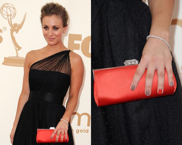 Kaley Cuoco's single red nail made her tan manicure pop at the 2011 Emmys.  See how a single color statement nail can also make your manicure pop here.