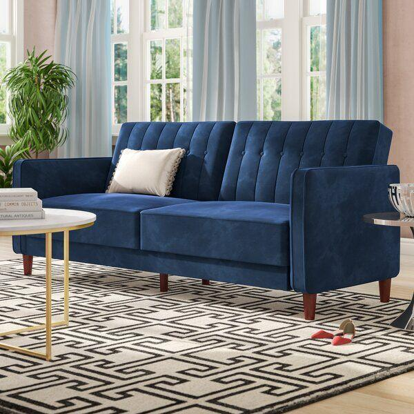 """<p><strong>Willa Arlo Interiors</strong></p><p>wayfair.com</p><p><strong>$449.90</strong></p><p><a href=""""https://go.redirectingat.com?id=74968X1596630&url=https%3A%2F%2Fwww.wayfair.com%2Ffurniture%2Fpdp%2Fwilla-arlo-interiors-nia-velvet-815-square-arm-sleeper-wrlo6780.html&sref=https%3A%2F%2Fwww.housebeautiful.com%2Fshopping%2Ffurniture%2Fg32981471%2Fmost-comfortable-futon%2F"""" target=""""_blank"""">BUY NOW</a></p><p>This transitional, channel-tufted futon scores high points for comfort and may just be the best reviewed sleeper on the internet. It folds down to form a twin bed, and this velvet-upholstered piece is priced well <em>and</em> comes in a rainbow of colors.</p>"""