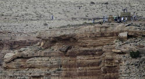 Daredevil Nik Wallenda crosses a tightrope 1,500 feet above the Little Colorado River Gorge, Ariz., on Sunday, June 23, 2013, on the Navajo Nation outside the boundaries of Grand Canyon National Park. Wallenda completed the tightrope walk that took him a quarter mile across the gorge in just more than 22 minutes. (AP Photo/Rick Bowmer)