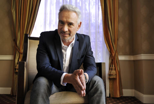 "In this Tuesday, June 18, 2013 photo, Roland Emmerich. director of the film ""White House Down,"" poses for a portrait in Beverly Hills, Calif. The action-packed film starring Jamie Foxx as the President of the United States of America and Channing Tatum as his impromptu bodyguard releases Friday, June 28, 2013. (Photo by Chris Pizzello/Invision/AP)"