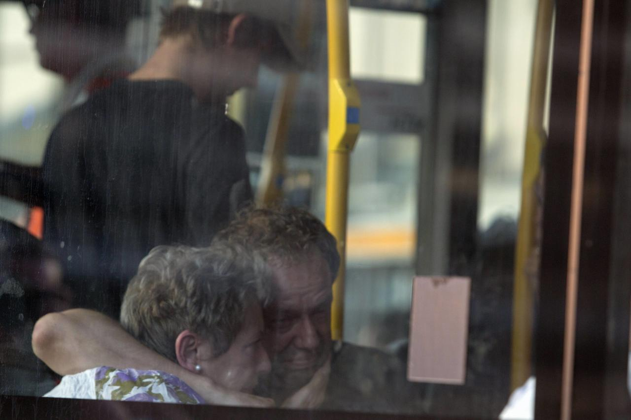 Family members of passengers on Malaysia Airlines flight MH17 react on a bus bringing them to a separate area at Schiphol Airport July 17, 2014. The Malaysian airliner was brought down over eastern Ukraine on Thursday, killing all 295 people aboard and sharply raising the stakes in a conflict between Kiev and pro-Moscow rebels in which Russia and the West back opposing sides. REUTERS/Cris Toala Olivares (NETHERLANDS - Tags: TRANSPORT DISASTER)