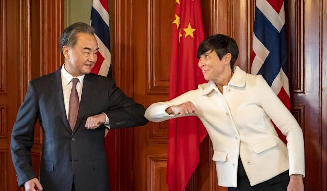 Norway's Foreign Minister Ine Eriksen Søreide (at right) greets Chinese Foreign Minister Wang Yi on Thursday. Photo: EPA-EFE