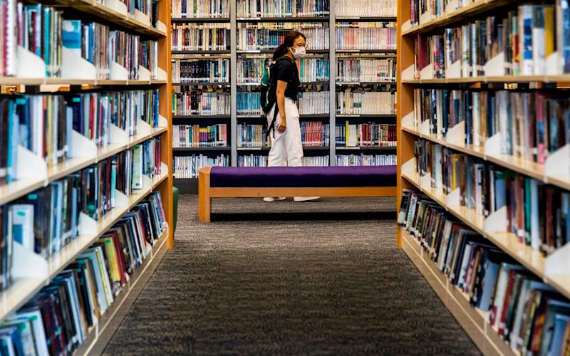 Books written by prominent Hong Kong democracy activists have started to disappear from the city's libraries, online records show, days after Beijing imposed a draconian national security law - ISAAC LAWRENCE/AFP