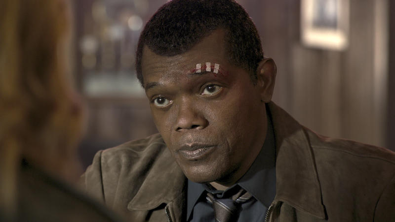 "This image released by Disney-Marvel shows Samuel L. Jackson as a younger Nick Fury in a scene from ""Captain Marvel. New digital de-aging techniques have shaved decades from Jackson's face. (Disney/Marvel Studios via AP)"