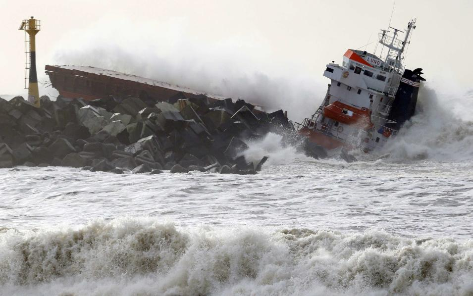 Waves are seen breaking against an empty Spanish cargo ship which broke in two on a seawall off the beach in Anglet on the Atlantic Coast of France