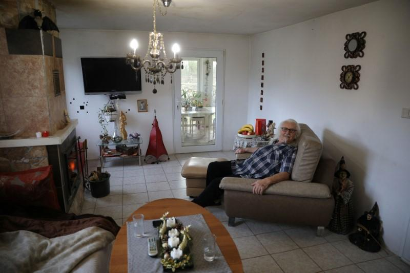Waldemar Hackstaetter is pictured inside his house in the village of Sirakovo