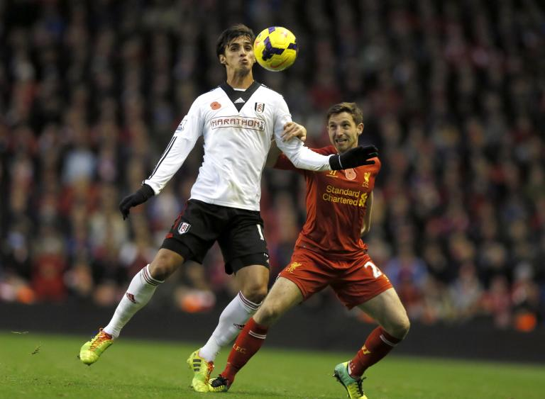Liverpool's Allen challenges Fulham's Ruiz during their English Premier League soccer match at Anfield in Liverpool