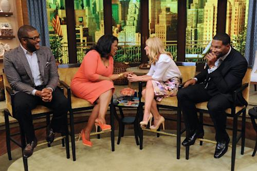 "This image released by Disney-ABC Domestic Television shows actor-director-producer Tyler Perry, left, with Oprah Winfrey, and co-hosts Kelly Ripa, second right, and Michael Strahan, right, on ""Live with Kelly and Michael,"" on Tuesday, May 28, 2013 in New York. (AP Photo/Disney-ABC Domestic Television, David Russell)"