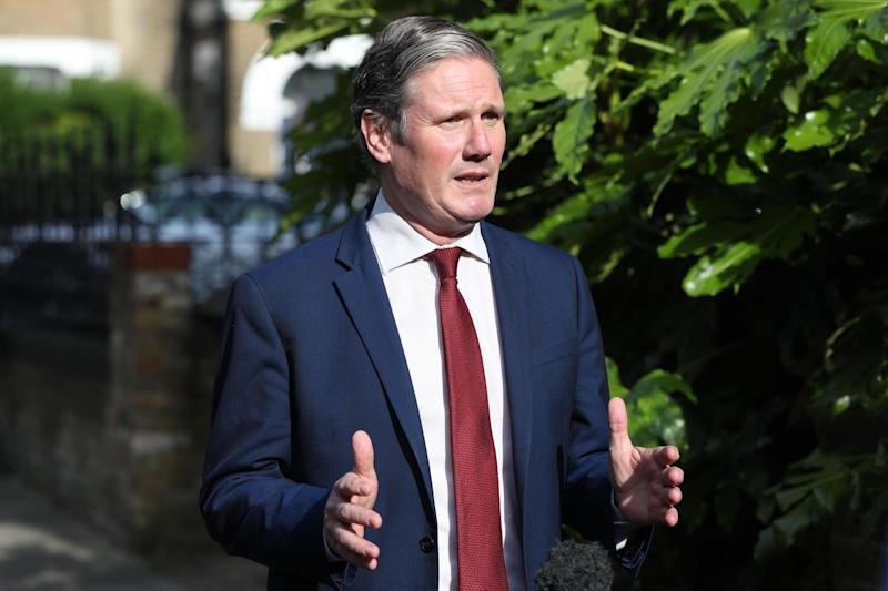Labour leader Sir Keir Starmer recording a piece to camera outside his home in north London: PA