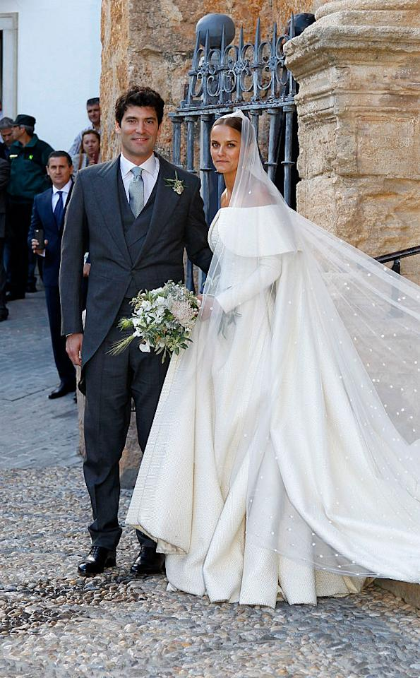<p>On May 28 2016, Lady Charlotte Wellesley and Alejandro Santo Domingo tied the knot in a Spanish ceremony. The bride donned a cold-shoulder dress by Emilia Wickstead and accessorised the look with a sweeping veil. Close friend, Camilla Parker-Bowles, was in attendance. <em>[Photo: Getty] </em> </p>