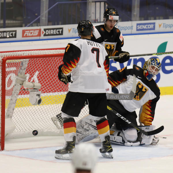 Germany goalkeeper Tobias Ancicka, right, fails to make a save as teammate Leon Huettl, left, looks on during the 2020 IIHF World Junior Ice Hockey Championships Group B match between Germany and USA in Ostrava, Czech Republic, on December 27th, 2019. (Petr Sznapka/CTK via AP)
