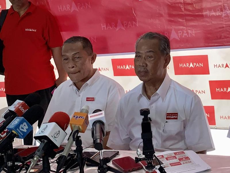 Tan Sri Muhyiddin Yassin (right) is pictured with Tanjung Piai candidate Karmaine Sardini in Rambah November 7, 2019. — Picture by Ben Ta