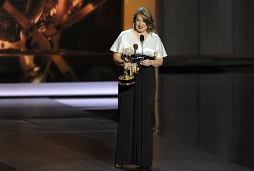 "Merritt Wever accepts the award for outstanding supporting actress in a comedy series for her role in ""Nurse Jackie"" at the 65th Primetime Emmy Awards at Nokia Theatre on Sunday Sept. 22, 2013, in Los Angeles. (Photo by Chris Pizzello/Invision/AP)"