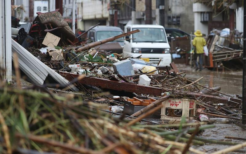 A street covered by Debris in a flood-affected area following torrential rain in Hitoyoshi - STR/AFP