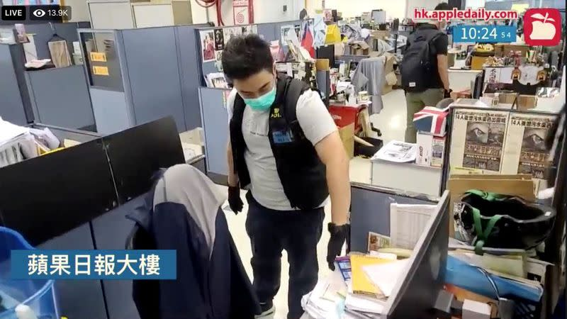 Hong Kong police raid on newspaper filmed in real time as China flexes muscles