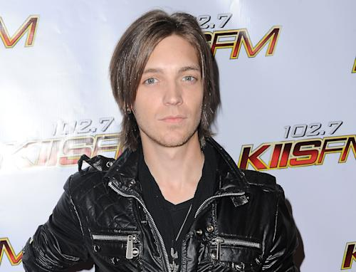 """FILE - This Dec. 5, 2009 file photo shows musician Alex Band at KIIS FM's Jingle Ball 2009 in Los Angeles. Band, a member of the rock band The Calling, reports being abducted and robbed after performing at a festival. The group tells The Associated Press that Alex Band was outside a store early Sunday when he was attacked. The group had performed in Lapeer, 45 miles north-northwest of Detroit. The Los Angeles-based group had the 2001 hit song """"Wherever You Will Go."""" It was used in several TV series and in the movie """"Coyote Ugly."""" (AP Photo/Katy Winn, File)"""