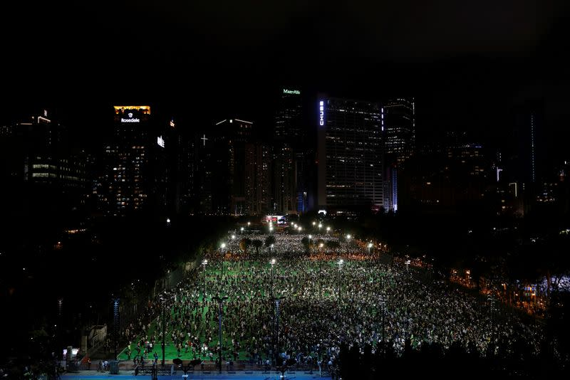 FILE PHOTO: Protesters take part in a candlelight vigil to mark the 31st anniversary of the crackdown of pro-democracy protests at Beijing's Tiananmen Square in 1989, in Hong Kong