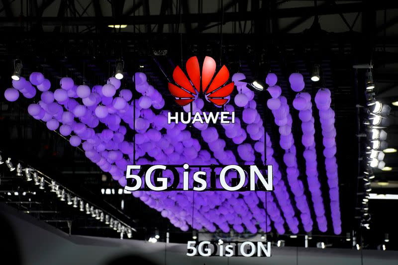 FILE PHOTO: A Huawei logo and a 5G sign are pictured at Mobile World Congress (MWC) in Shanghai