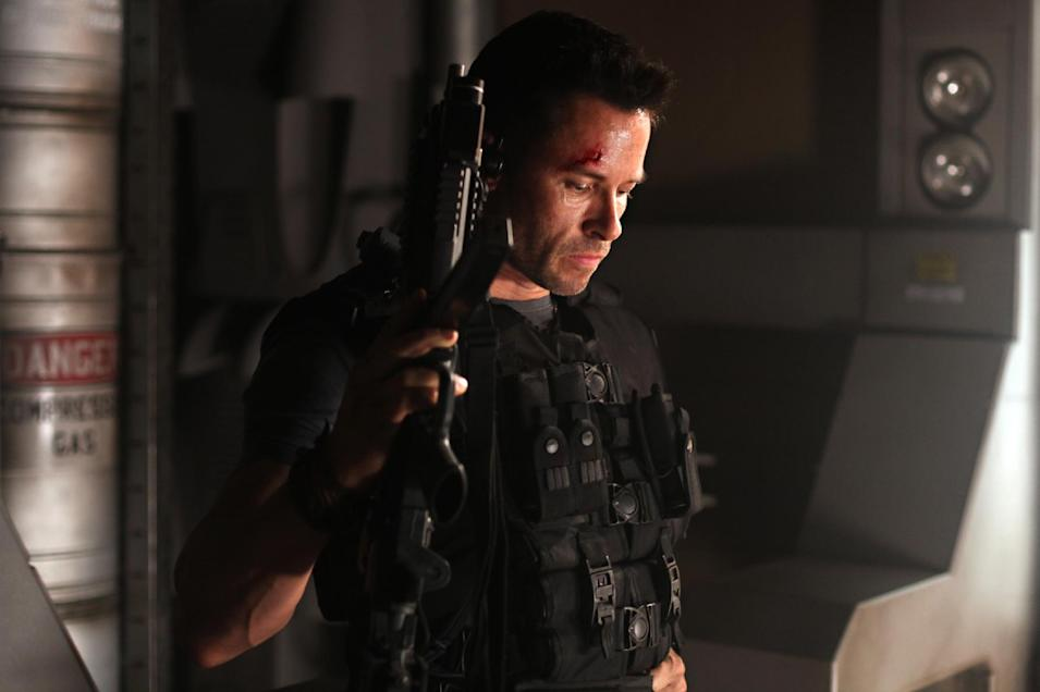 """In this film image released by Film District, Guy Pearce is shown in a scene from """"Lockout."""" (AP Photo/Film District)"""