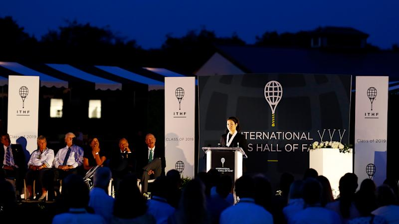 Li Na gives her speech after being inducted into the International Tennis Hall of Fame in Newport, Rhode Island on July 20, 2019. | Omar Rawlings— International Tennis Hall of Fame/Getty Images