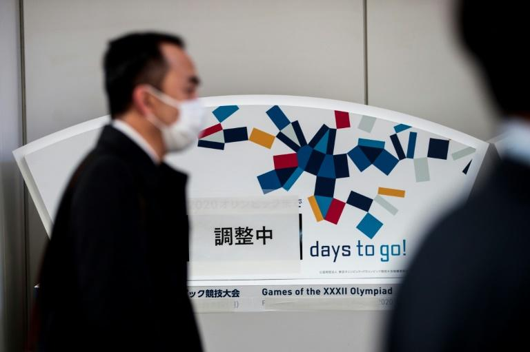 An Olympic countdown clock in Tokyo is now covered by a sign that reads 'under adjustment' in Japanese