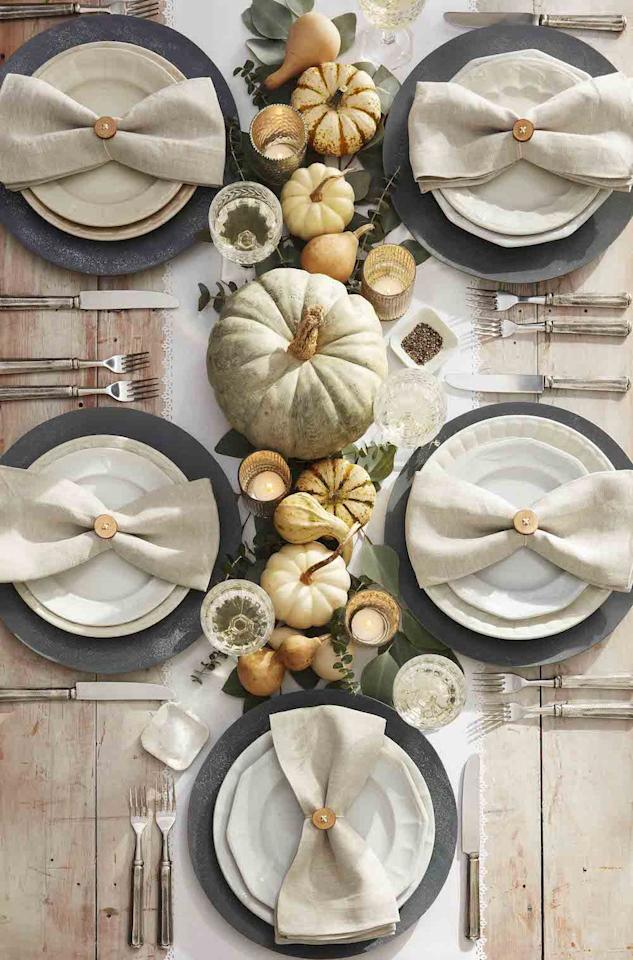 "<p>If bright orange and black isn't your favorite color combo, invoke the spirit of Halloween with whitewash painted pumpkins and a mix of neutral mini pumpkins and gourds.</p><p><strong><a class=""body-btn-link"" href=""https://www.amazon.com/YOFIT-Artificial-Decoration-Thanksgiving-Decorations/dp/B07VJBJFYK/?tag=syn-yahoo-20&ascsubtag=%5Bartid%7C10050.g.3739%5Bsrc%7Cyahoo-us"" target=""_blank"">SHOP MINI WHITE PUMPKINS</a></strong></p>"