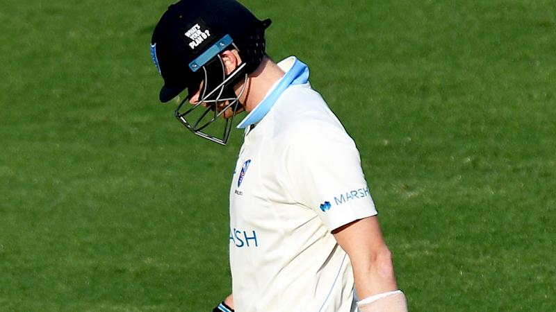 Steve Smith of New South Wales looks dejected after losing his wicket during day one of the Sheffield Shield match between Queensland and New South Wales at The Gabba on October 10, 2019 in Brisbane, Australia. (Photo by Bradley Kanaris/Getty Images)