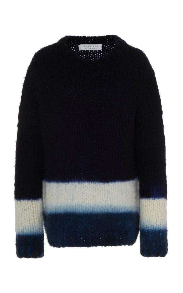 "<p><strong>Gabriela Hearst</strong></p><p>gabrielahearst.com</p><p><strong>$1990.00</strong></p><p><a href=""https://www.gabrielahearst.com/products/lawrence-dip-dye-sweater-navy-ivory-sapphire?variant=29490105188431"" target=""_blank"">Shop Now</a></p><p>The Lawrence Dip Dye Sweater in cashmere was made by Manos del Uruguay, a nonprofit that empowers women in Uruguay. As a Latin woman living in New York for the past 20 years, it has informed the perspective that I possess as a creative of these worlds—my native culture and adopted one. My children are born from a first-generation immigrant and proud of it.</p>"