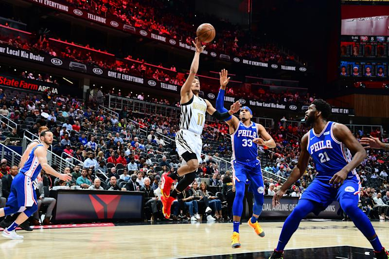 ATLANTA, GA - MARCH 23: Trae Young #11 of the Atlanta Hawks shoots the ball against the Philadelphia 76ers on March 23, 2019 at State Farm Arena in Atlanta, Georgia. NOTE TO USER: User expressly acknowledges and agrees that, by downloading and/or using this Photograph, user is consenting to the terms and conditions of the Getty Images License Agreement. Mandatory Copyright Notice: Copyright 2019 NBAE (Photo by Scott Cunningham/NBAE via Getty Images)