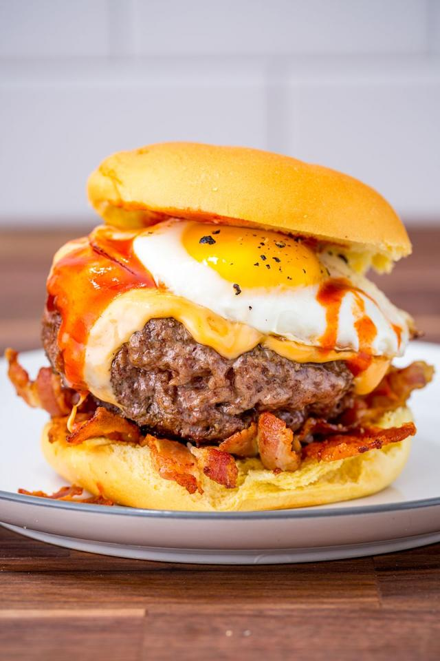 """<p>Brunch goals.</p><p>Get the recipe from <a href=""""https://www.delish.com/cooking/recipe-ideas/recipes/a47644/cheesy-breakfast-burger-recipe/"""" target=""""_blank"""">Delish</a>.</p>"""