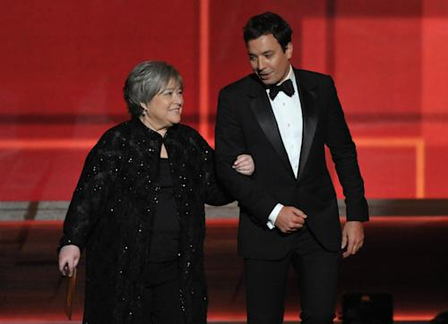 Kathy Bates, left, and Jimmy Fallon present an award onstage at the 64th Primetime Emmy Awards at the Nokia Theatre on Sunday, Sept. 23, 2012, in Los Angeles. (Photo by John Shearer/Invision/AP)