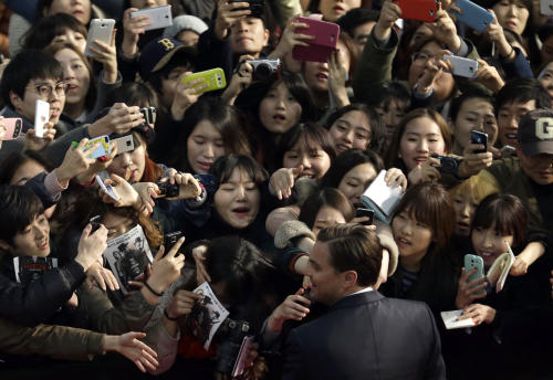 """Actor Leonardo DiCaprio is mobbed by fans during the premiere of his new film """"Django Unchained"""" in Seoul, South Korea, Thursday, March 7, 2013. DiCaprio is here to promote the film which is to be released in South Korea on March 21. (AP Photo/Lee Jin-man)"""