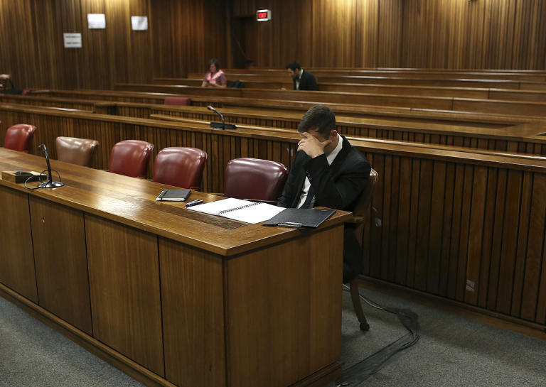 Oscar Pistorius sits in court before the fourth day of sentencing proceedings in the high court in Pretoria, South Africa, Thursday, Oct. 16, 2014. Yesterday saw the first family member, first cousin of the late Reeva Steenkamp, Kim Martin, testified at the double-amputee athlete's trial. Pistorius faces up to 15 years in prison after being convicted of culpable homicide, or negligent killing, for shooting Steenkamp, although he could also receive a suspended jail sentence and a fine. (AP Photo/Alon Skuy, Pool)