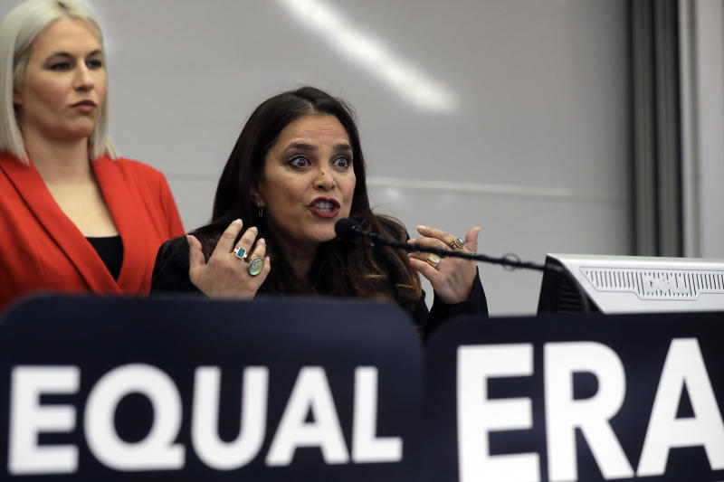 Kamala Lopez, right, president of Equal Means Equal, faces reporters as Natalie White, left, vice president of the organization, looks on during a news conference, Tuesday, Jan. 7, 2020, in Boston, held to address issues about a lawsuit filed in U.S. District Court. Supporters of the Equal Rights Amendment filed the federal lawsuit in Massachusetts aimed at paving the way for adoption of the long-delayed constitutional amendment. (AP Photo/Steven Senne)