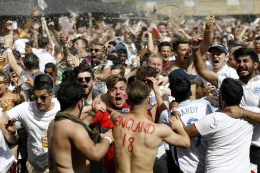 England fans in London celebrate as Harry Maguire scores against Sweden