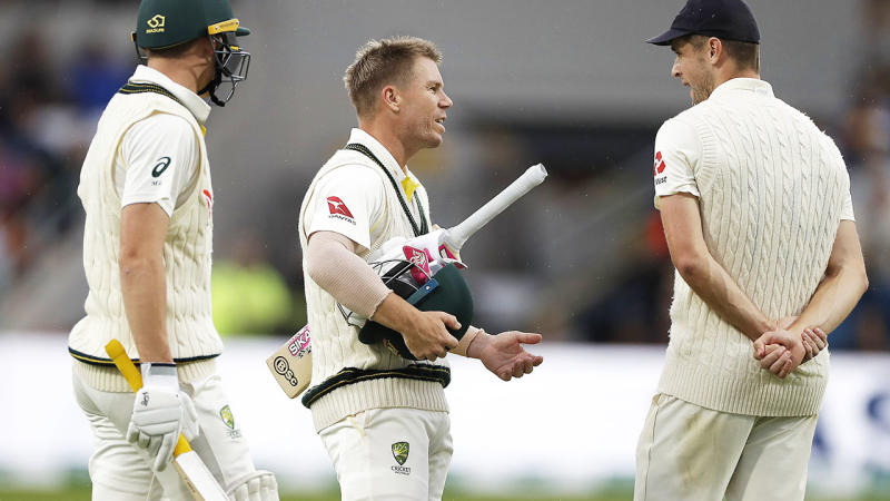 Marnus Labuschagne and David Warner, pictured here leaving the field when bad light stopped play.