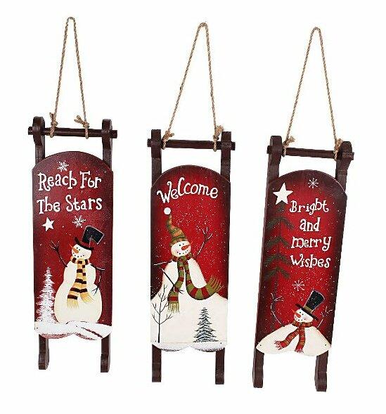 Snowman Christmas 3 Piece Hand Painted Sleigh Set. Image via Wayfair.