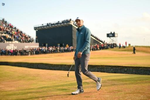 Jordan Spieth walks onto the 18th green during his second round