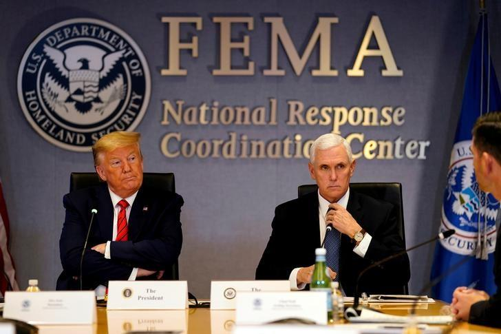 U.S. President Donald Trump and Vice President Mike Pence attend a meeting at the Federal Emergency Management Agency headquarters, in Washington