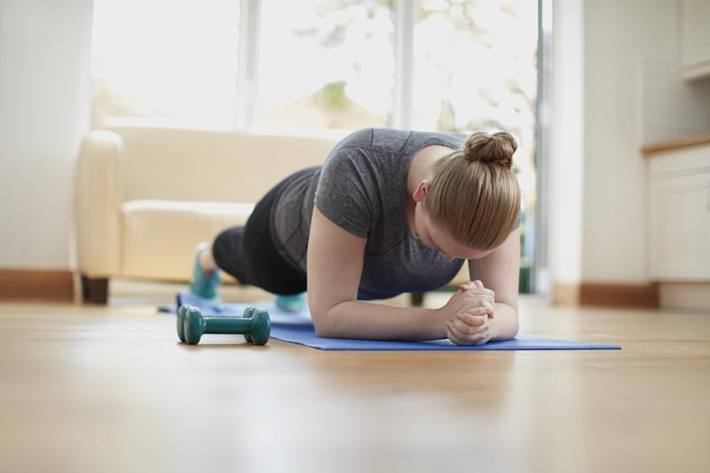 Young woman in plank position.