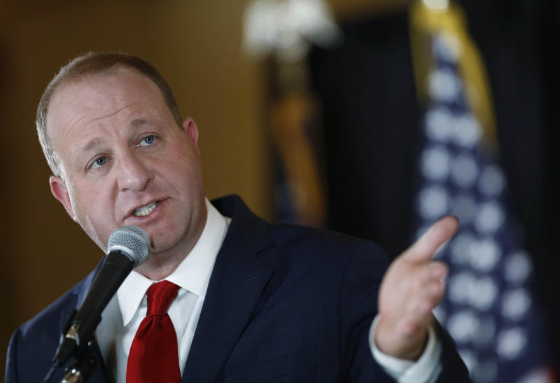 Colorado Gov. Jared Polis makes a point duiring a news conference to update the state's efforts to check the spread of the new coronavirus Monday, May 11, 2020, in Denver. (AP Photo/David Zalubowski)