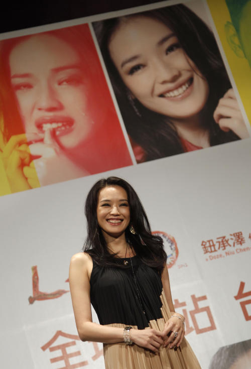 "Taiwanese actress Shu Qi poses during a media event in the lead up to the premiere of her new film entitled ""Love"" in Taipei, Taiwan, Tuesday, Feb. 7, 2012. The romantic drama ""Love"" opens on Valentine's Day, Feb. 14, 2012. (AP Photo/Wally Santana)"