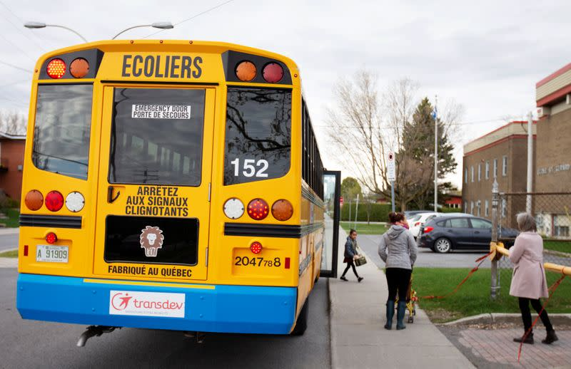 A school bus arrives carrying one student as schools reopen outside the greater Montreal region in Saint-Jean-sur-Richelieu